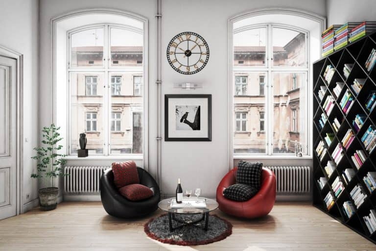 A well lit apartment room with white colored walls and a cool wall clock on the wall, How To Decorate Around A Wall Clock? [5 Fun Tips!]