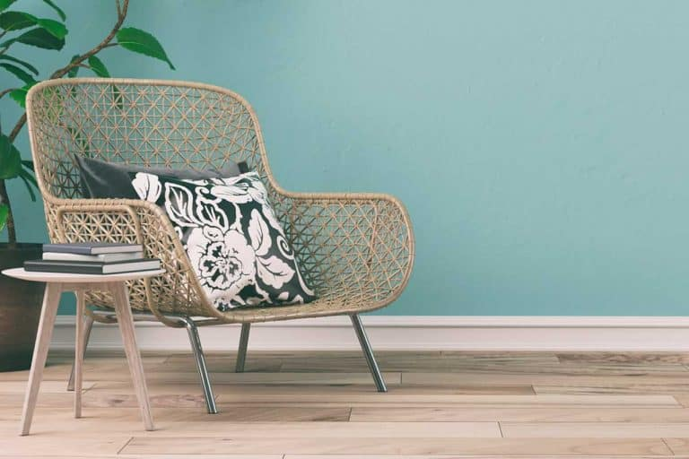A wicker chair in an empty retro interior with mint colored wall, How to refurbish a wicker chair?