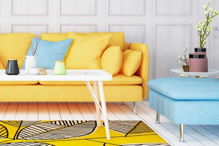 A yellow sofa matched with sky blue ottoman, Should Ottoman Match Sofa? [Inc. 3 Coordination Tips]