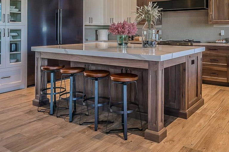 Bar stools and kitchen island in uniqely designed kitchen, How Far Should A Bar Stool Be From The Counter?
