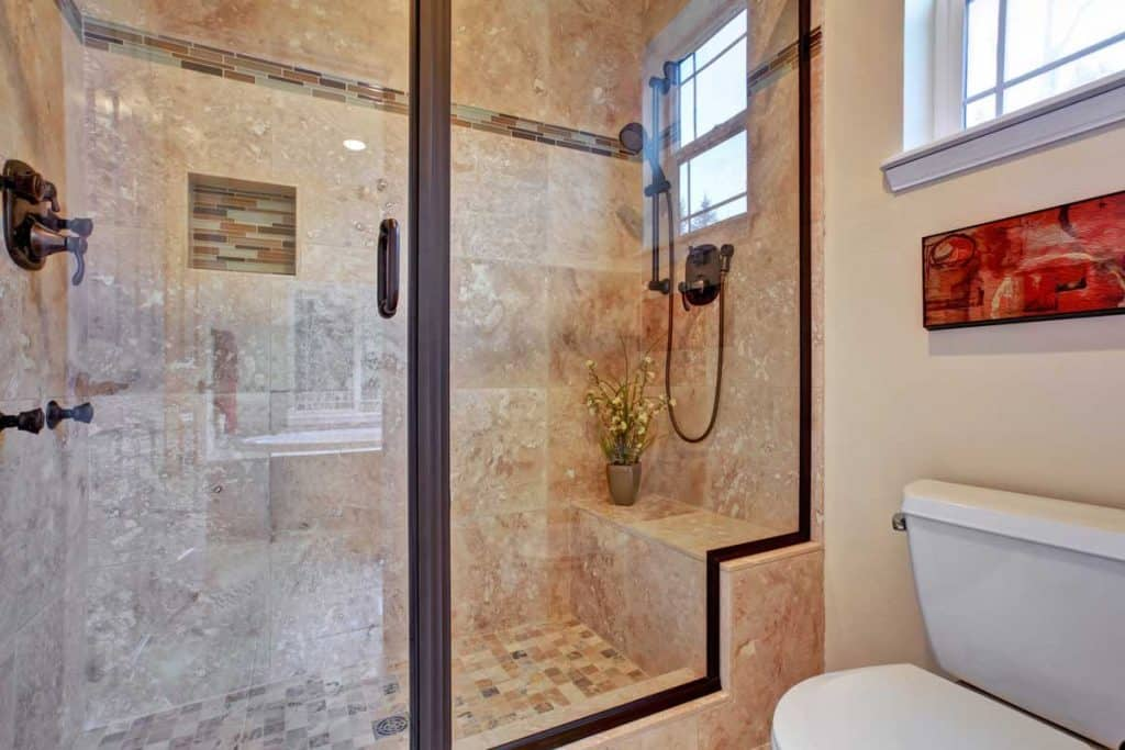 Bathroom with screened shower and framed shower door