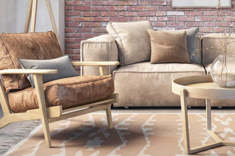 Beige leather sofa and accent chair in a bohemian living room interior with brick wall, What Accent Chairs Go With A Leather Sofa?