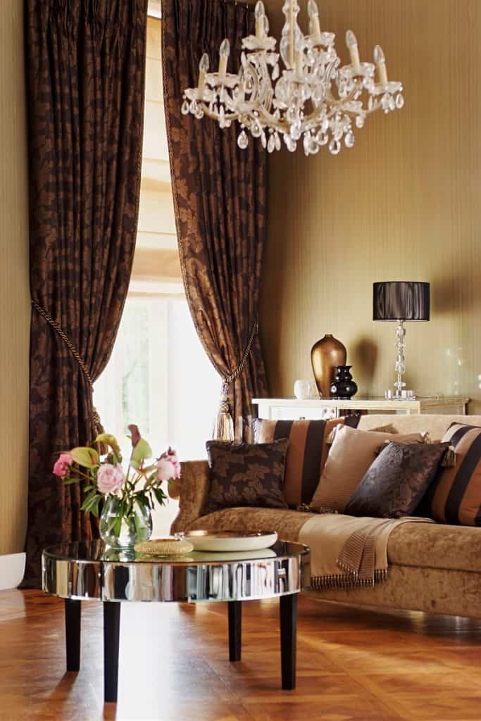 Brown themed living room with a brown flooring and furnitures incorporated with a brown curtain