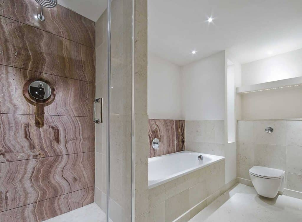 Contemporary bathroom with marble details