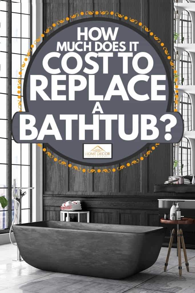 A black and gray themed bathroom with a dark granite colored bathtub, How Much Does it Cost to Replace a Bathtub?