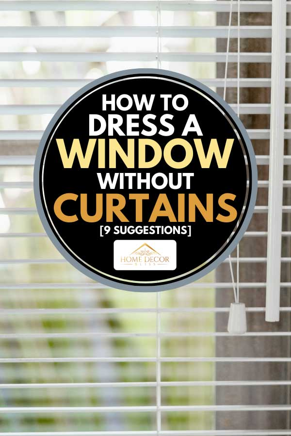 Sunlight coming through blinds by the window, How To Dress A Window Without Curtains [9 Suggestions]
