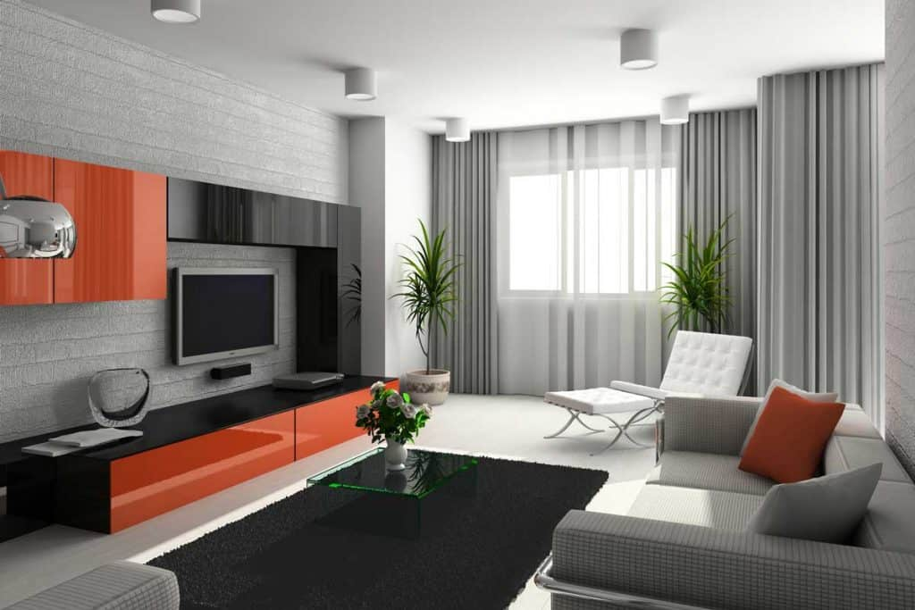 Interior of modern living-room with gray sofa and accent chair