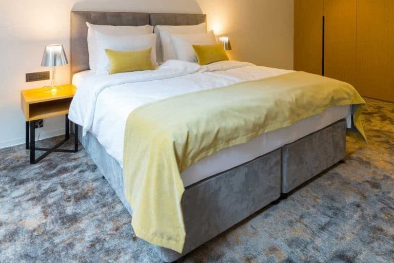 Hotel bedroom interior with king size bed, How Big Is A King Size Bed? [Various Types Discussed]