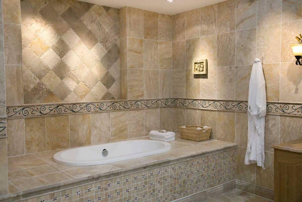 Luxurious modern bathroom with matching bathroom floor and wall tiles