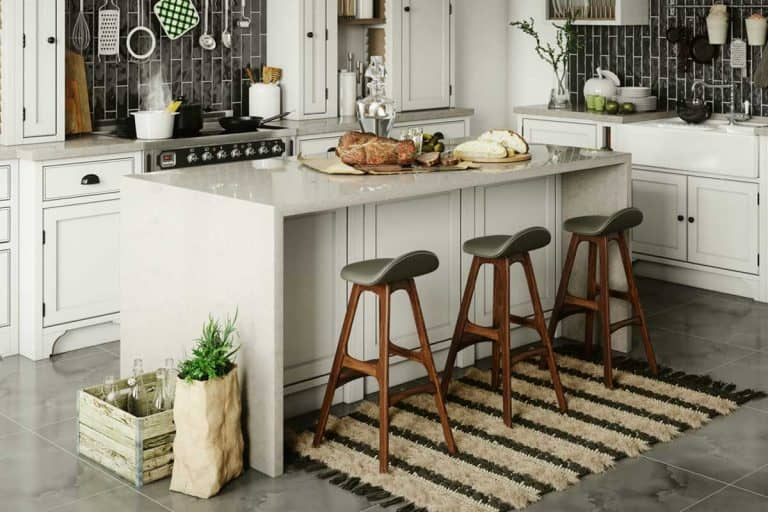 Luxury domestic kitchen interior with breakfast bar and rustic elements, How Much Should A Breakfast Bar Overhang?