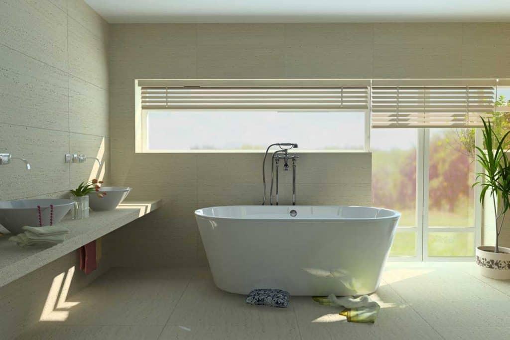 Modern bathroom with bathtub with matching bathroom floor and wall tiles