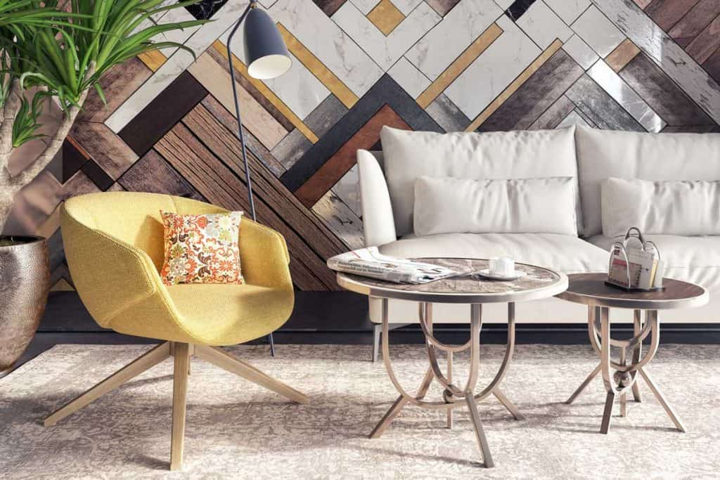Modern interior with yellow armchair in front of a accent wall stock photo