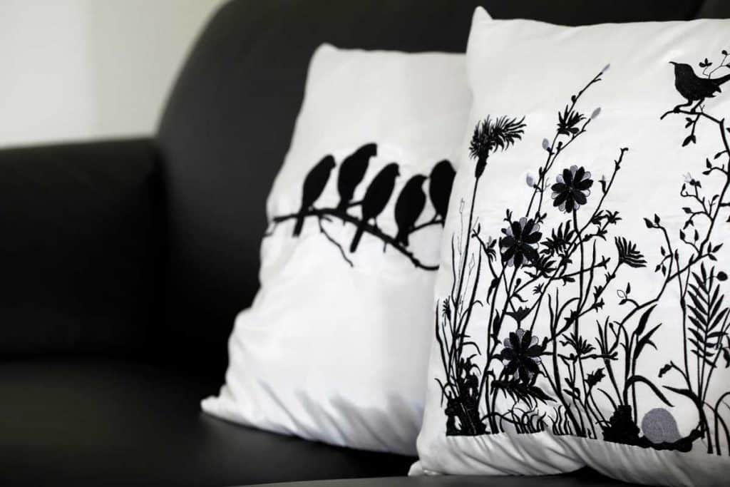 Pillows on the black couch