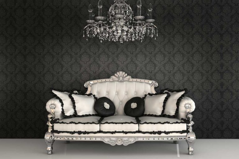 Royal sofa with pillows and chandelier in luxurious interior