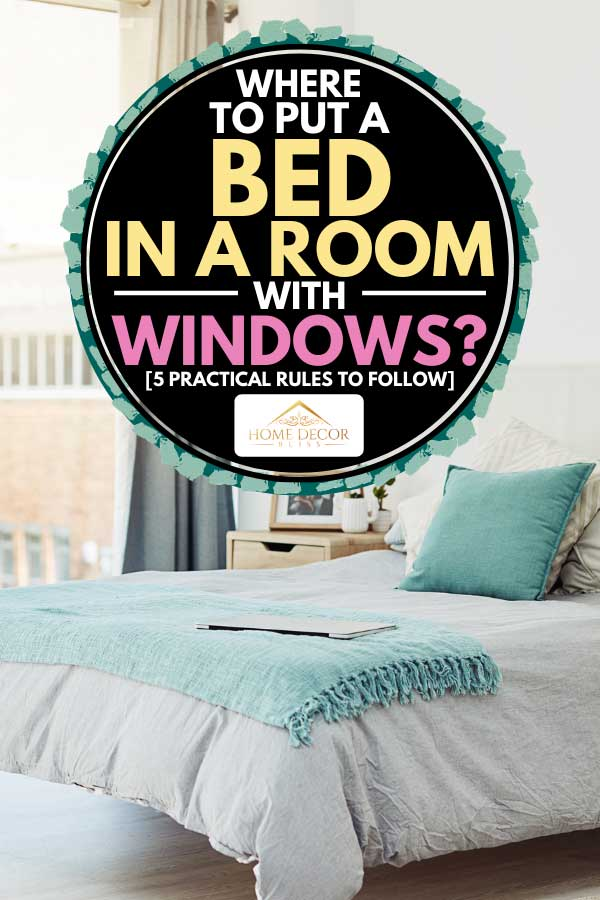 Neatly arranged bedroom with large glass window, Where To Put A Bed In A Room With Windows? [5 Practical Rules To Follow]