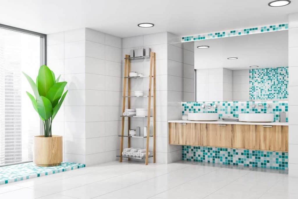 White and blue mosaic bathroom with double sink