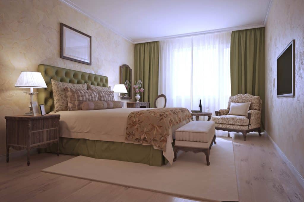 A Mediterranean bedroom with the incorporation of green and beige colors along the whole room