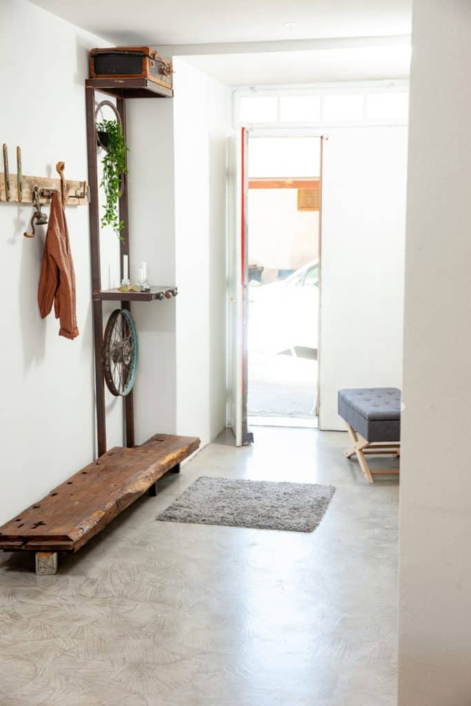 A modern entryway with a cloth hanger