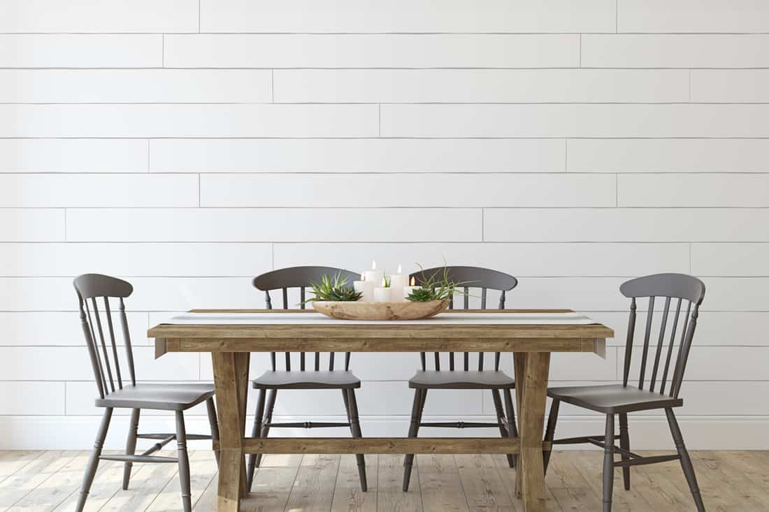 A modern farmhouse themed dining room with wooden chairs and wooden flooring, How to Paint a Dining Room Table [4 Steps]