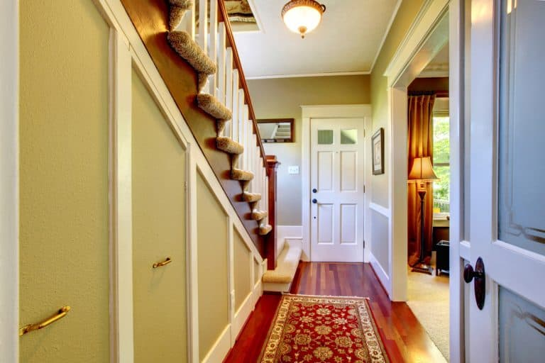 A rustic themed house, traditional designed door and protruding staircase, How to Decorate a Split Level Entryway [6 Suggestions]