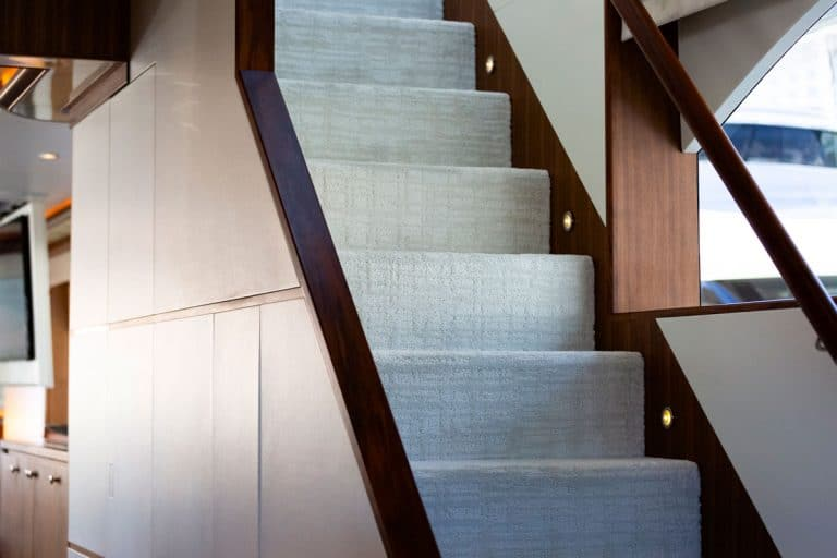 A A gray straight stair on a modern house with pin lights for lighting spaced apart by two steps, How To Remove Carpet From Stairs