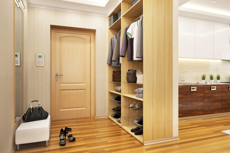 An entryway cabinet inside a modern farmhouse themed living room, How To Best Organize The Entryway Closet [5 Steps]