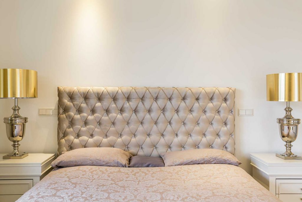 Bed with quilted headboard