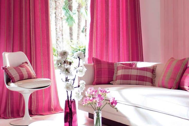 Contemporary living room with sofa and pink curtains, 4 Types of Curtains that Are Best for Privacy