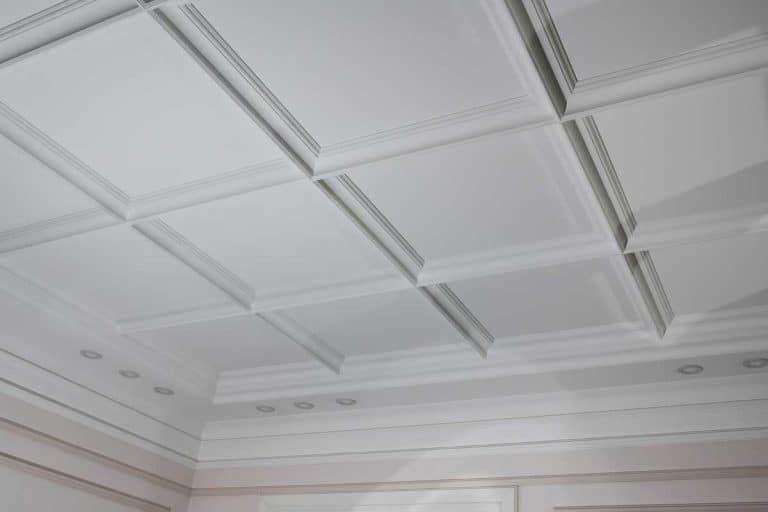 Detail of ceiling moldings in a house interior, Does Crown Molding Make A Room Look Bigger Or Smaller?