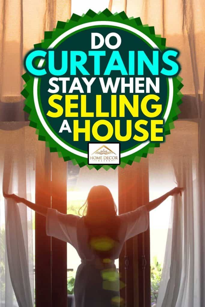 Young woman in bathrobe open curtains and stretch standing near the window at home, Do Curtains Stay When Selling A House?