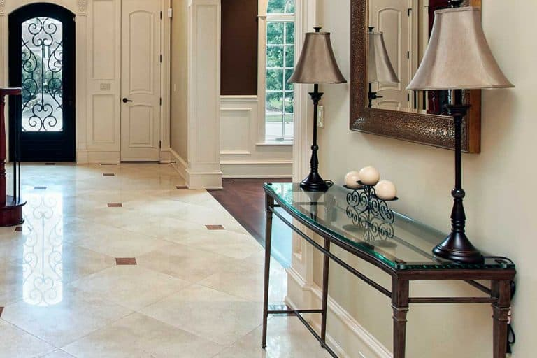 Foyer of a luxury home with entryway table and mirror, How To Style Entryway Table? 6 Interior Design Styles Suggested