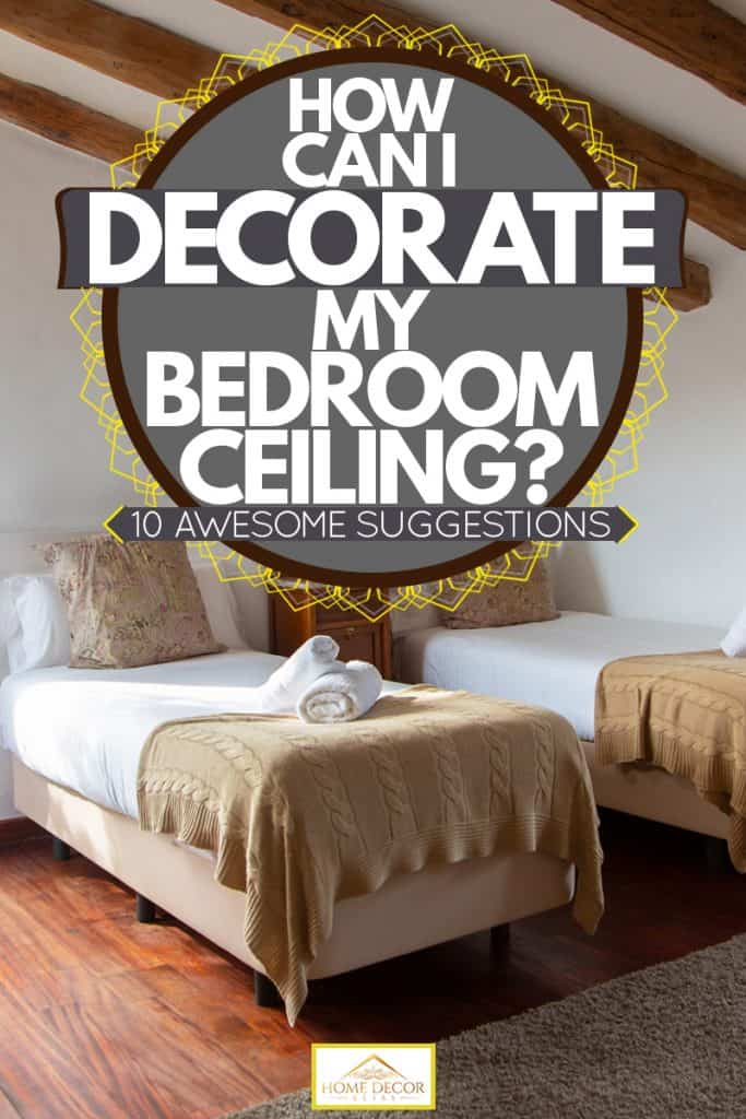 A rustic themed bedroom with two single person beds blended with a wooden nightstand in the middle, How Can I Decorate My Bedroom Ceiling? [10 Awesome Suggestions]