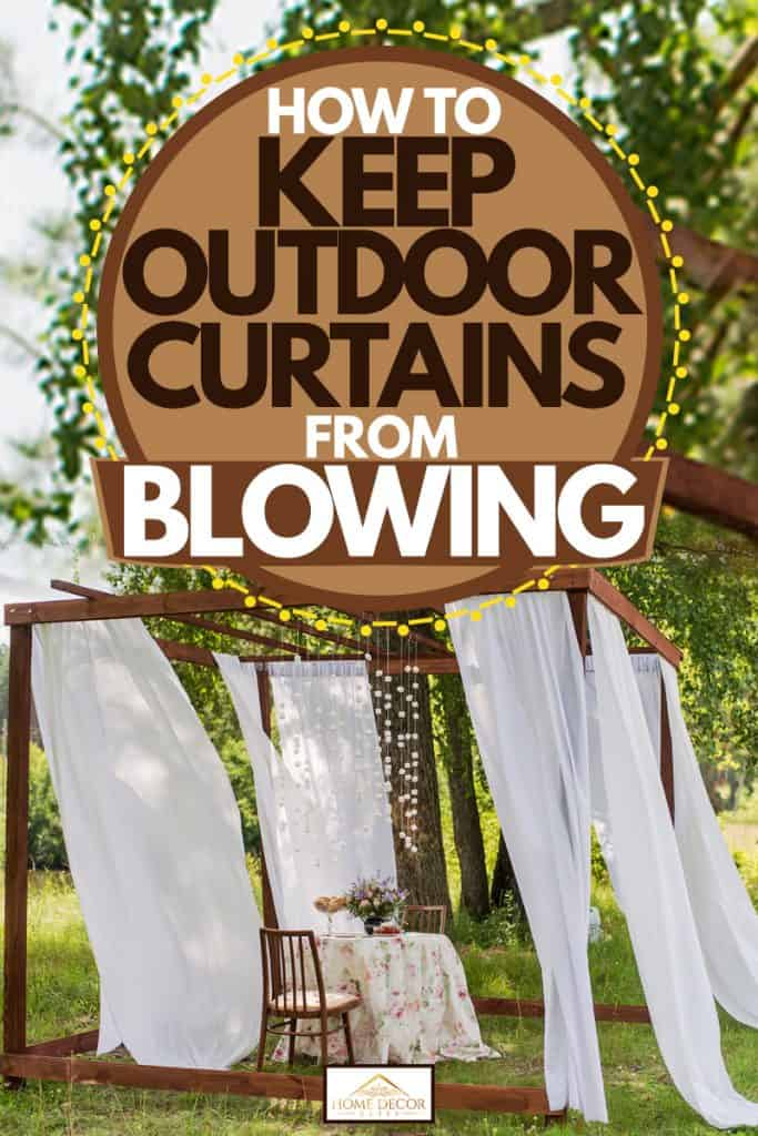 An outdoor gazeebo with white outdoor curtains and a dining table with chairs in the middle, How To Keep Outdoor Curtains From Blowing
