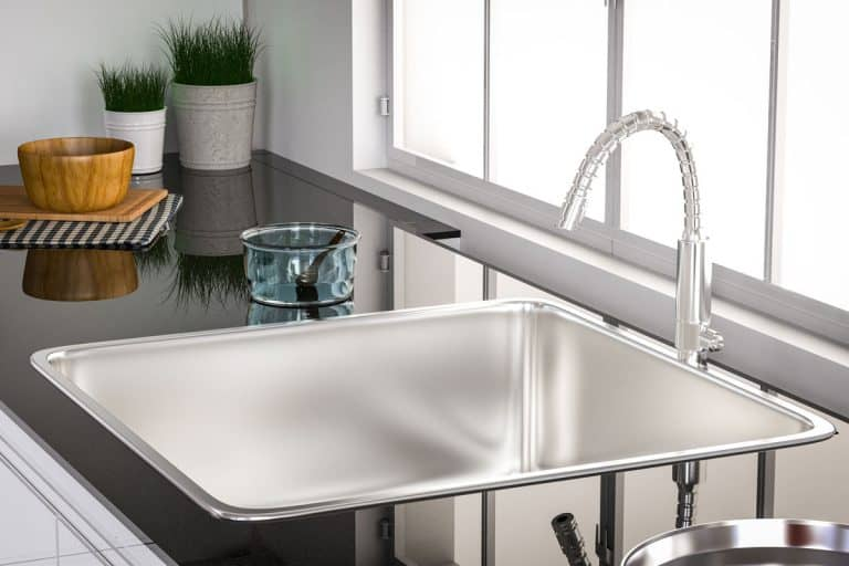 Interior of a modern domestic kitchen with water faucet closeup, How long do kitchen sinks last