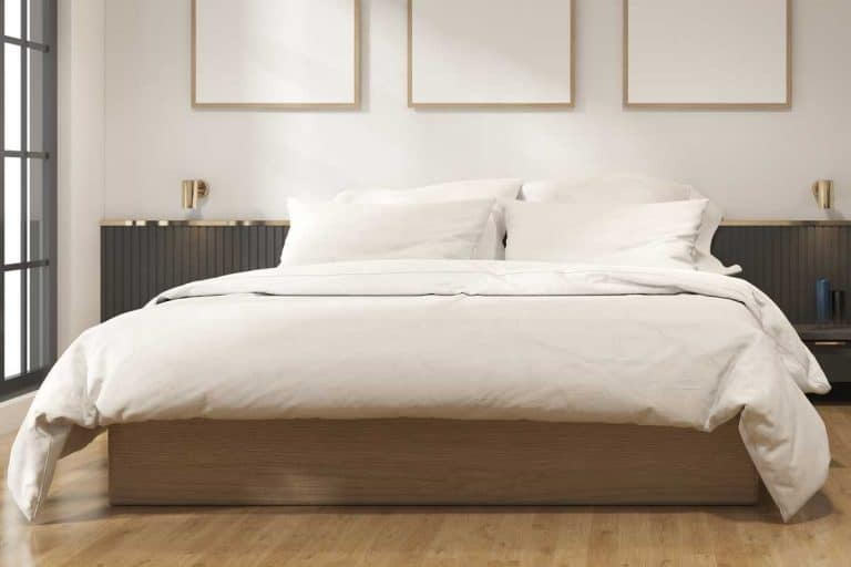 Modern bedroom with white bed and blank picture frames on wall, Can You Put Vinyl Flooring In Bedroom?