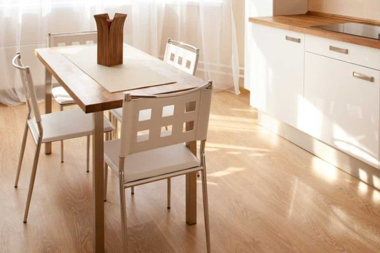 Modern bright kitchen interior with dining table and chairs, How High Should A Dining Table Be?