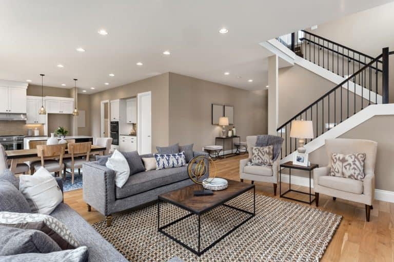 Modern living room with a gray touch to it combined with the colors brown on the flooring and gray to the furnitures, Should Ceiling Paint Match Trim? [Design Options Explored]