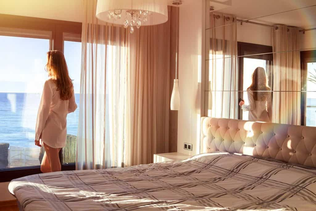 Waking up in the morning in the bedroom with seascape view window