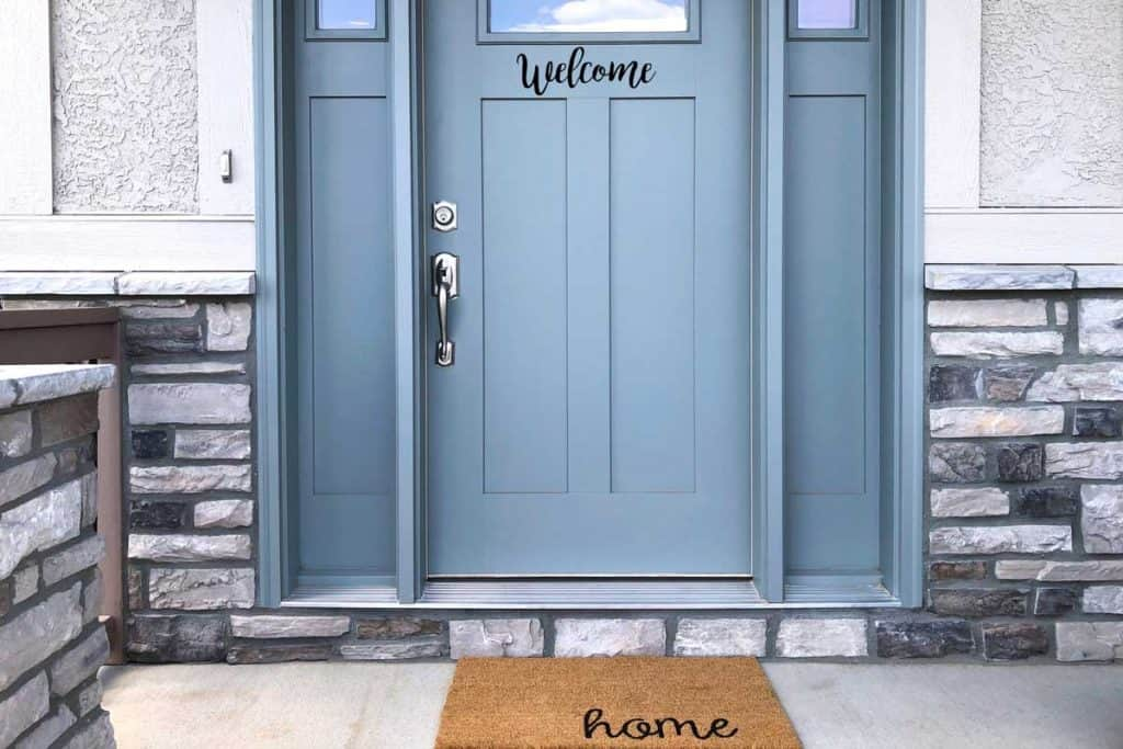 welcome signage and home floor mat at entryway