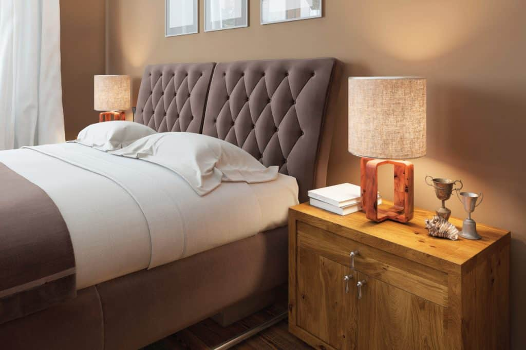 Wooden bedside tables with expressive textures in a modern bedroom