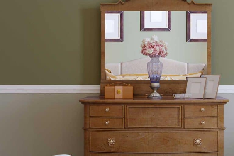 Wooden dresser with mirror in a classic bedroom, Do Dressers Need Mirrors? Here's what you need to know