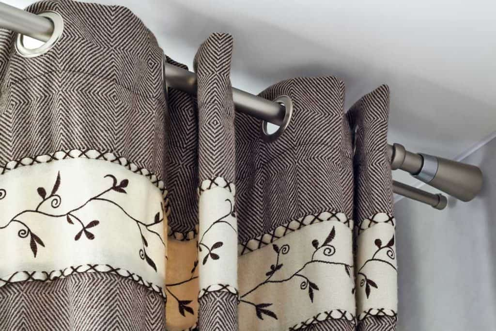 heavy woolen braun curtains with ring-top rail