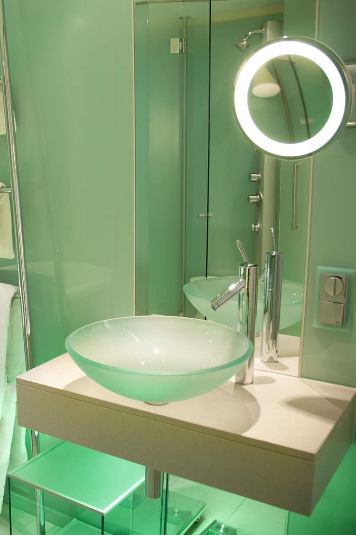 modern american bathroom with tempered glass sink