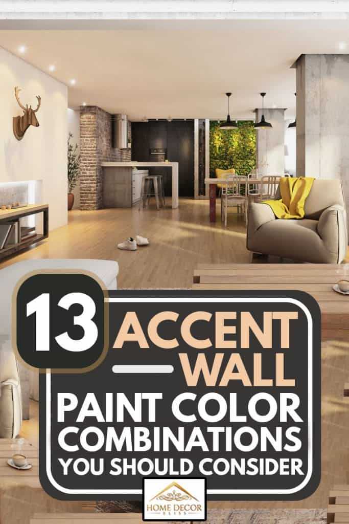 A spacious living room with cream colored accent wall with wooden laminated flooring, 13 Accent Wall Paint Color Combinations You Should Consider