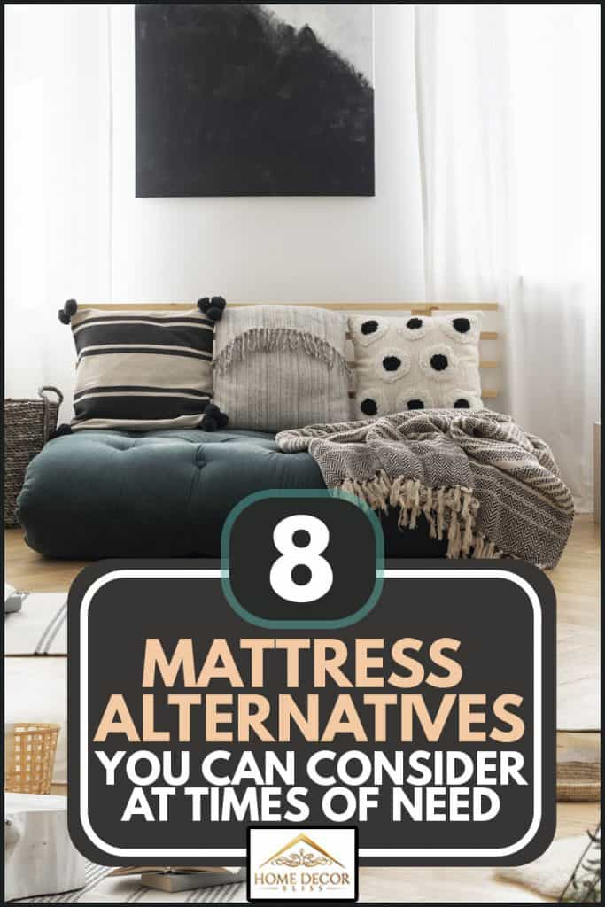 Poster above green futon with patterned pillows in bright living room interior, 8 Mattress Alternatives You Can Consider At Times of Need