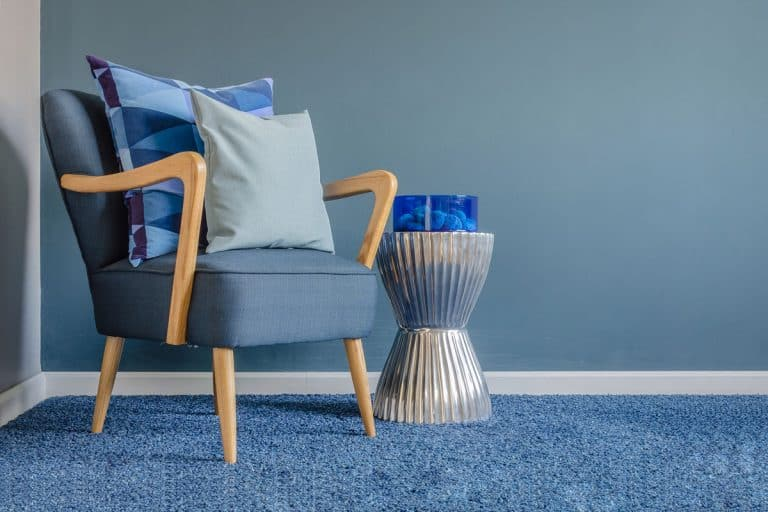 Blue themed room with a blue carpet, blue walls and a blue chair with throw pillows on it, Carpet Smells Like Stinky Feet? Here's What To Do