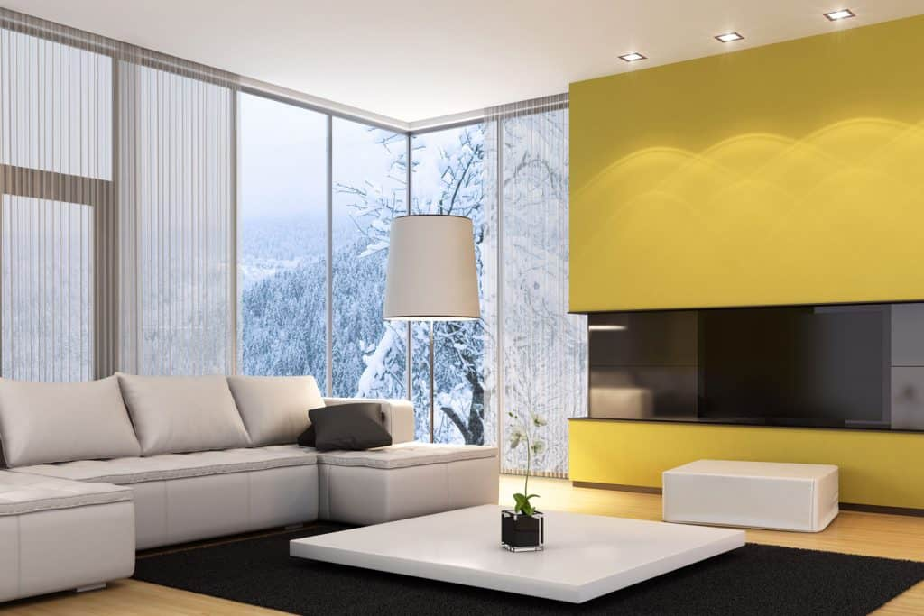 A luxury living room overlooking a winter landscape