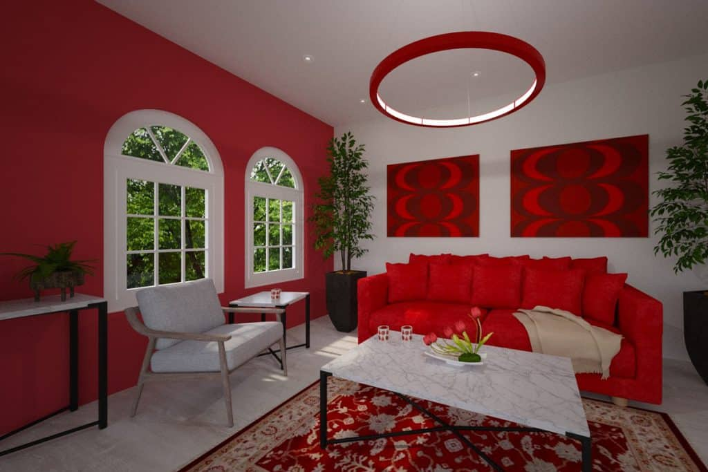 A modern Mediterranean themed living room with red mural paintings, a red accent wall, and red colored sofa with an area rug underneath