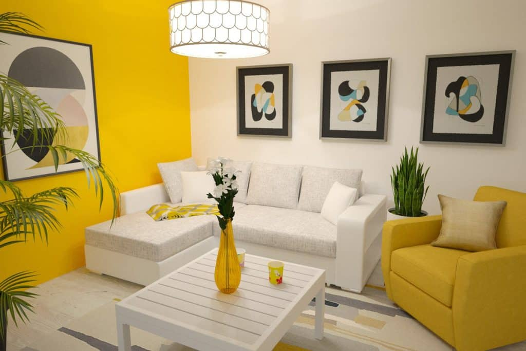 A modern living room with a yellow accent walls with indoor plant placed next to furniture