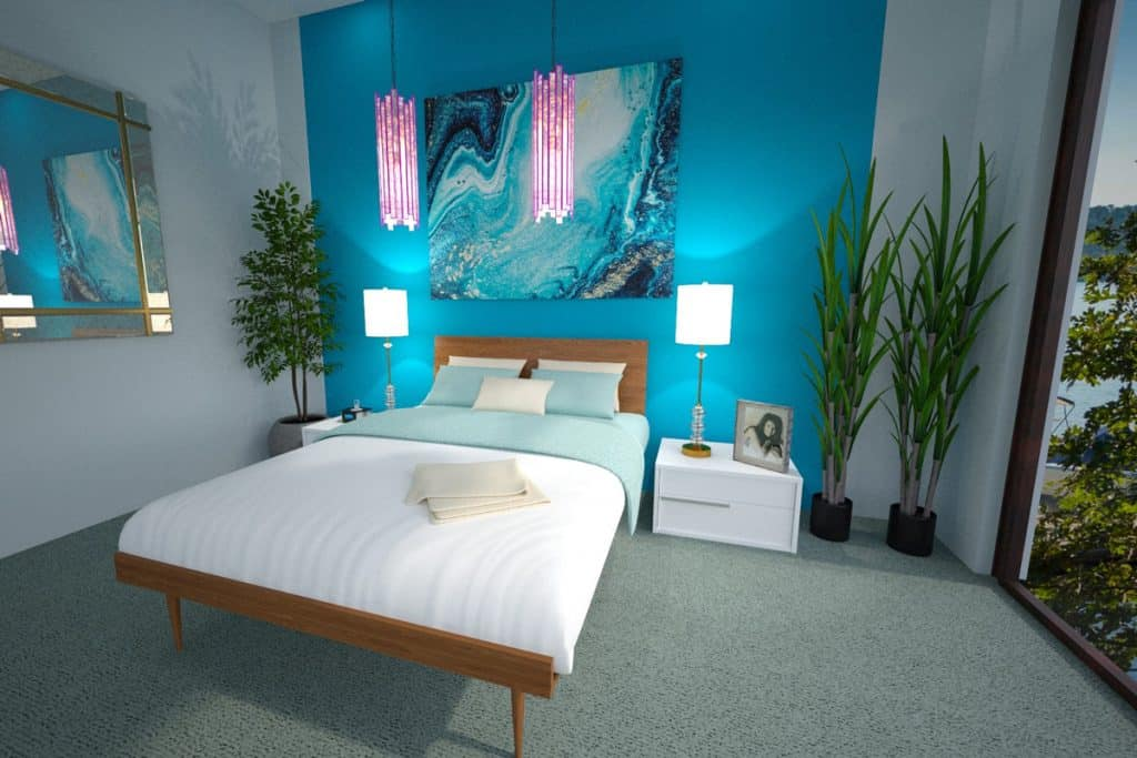 A modern tropical themed bedroom with a blue centerpiece accent wall with a mural art on it